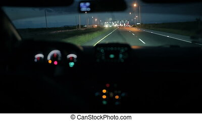 Car at the toll collection point at night - Car coming at...