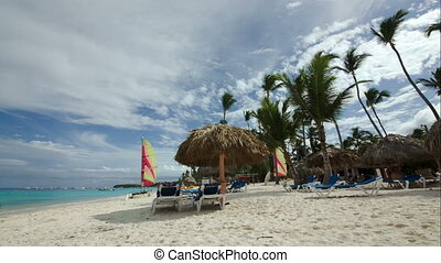 Tropical beach with chaise-longues and sun umbrellas - Beach...