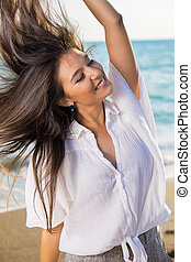 Dancing Woman with Flying Hair at the Beach - Close up...