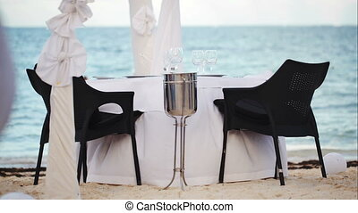 Served empty table on the shore in black and white colors -...
