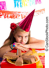 Bored blond kid girl in party with chocolates
