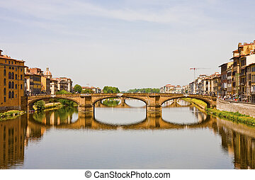 Arno River Bridge - A bridge over the calm Arno river in...