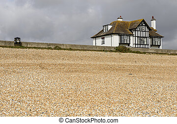 shingle beach and old cottage at New Romney - landscape of...