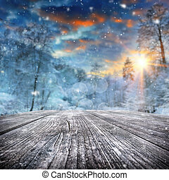 Winter landscape with snow covered forest at sunset