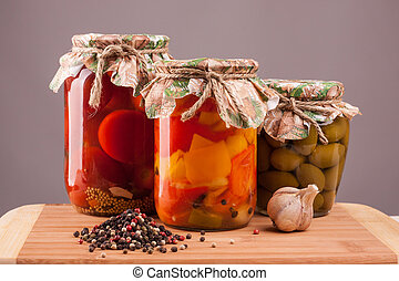 pickled vegetables in a glass on a wooden table