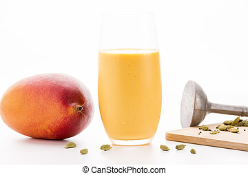 One Glass Of Mango Lassi And A Whole Fruit - Closeup on a...