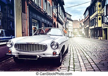 Retro car in old city street - Retro car parked in old...