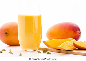 Cut Mango Pieces, Cardamon And Fruit Shake - Close-up on cut...