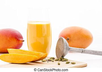Mango Flesh, Cardamom, Pestle And Mango Mocktail - Closeup...