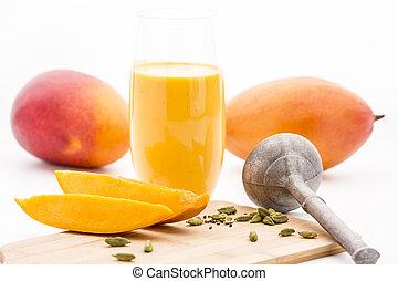 Crushed Cardamon, Pestle, Mangos And Mango Lassie - Close-up...