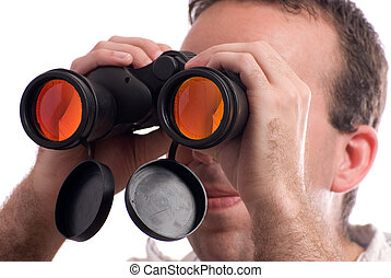 Spy - Closeup view of a man spying with a set of binoculars,...
