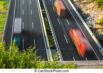 motion trucks on the freeway.