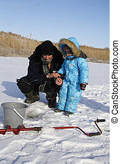 Winter fishing with grandpa - 4 year old boy on winter...