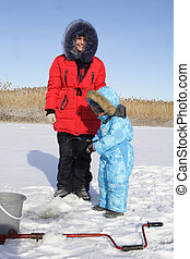 Winter fishing with mom - 4 year old boy on winter fishing...