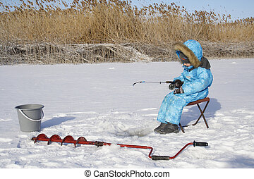 Winter fishing Young fisherman - 4 year old boy on winter...