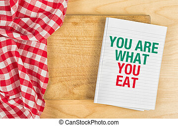 You Are What You Eat Message in Recipe Notebook on Kitchen...