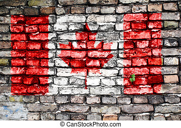 Flag of Canada painted on an old brick wall with small ivy...