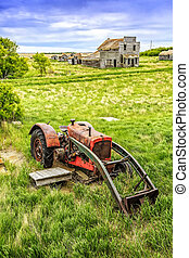 Old Red Tractor - An old red tractor rusting away in a small...