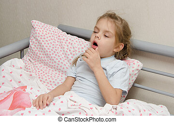 Diseased girl lying in bed coughing - Six year old girl...