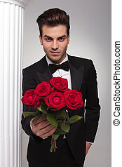 business man giving you a bouquet of red roses - Happy young...