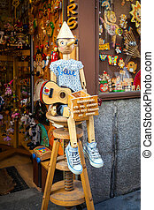 Vintage wood toy shop with Pinocchio dool exposed on front...