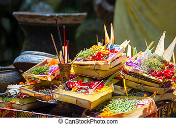 Hindu offerings at the temple in Bali, Indonesia - Hindu...