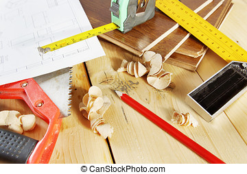 Still life with carpenter working tools on the wooden workbench