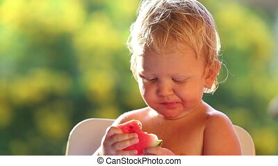 baby girl eat watermelon - small blonde baby girl eat red...