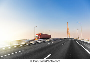 truck at highway - highway and modern bridge of city