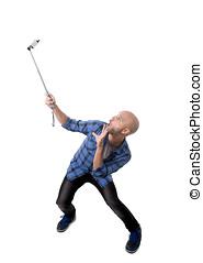 young Hispanic man in casual shirt having fun shooting...