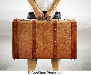 men holding leather suitcase on a white background