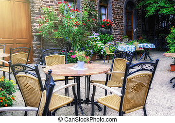 Cafe terrace in small European city at summer day