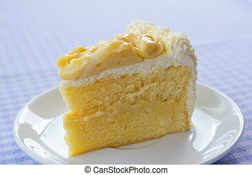 coconut cake - a piece of coconut cake on plate with napery