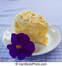 coconut cake and flower - a piece of coconut cake on plate...
