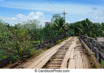 Crumbling tropical bridge - Worn, weathered, crumbling and...