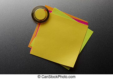 Overlapping stickies - Four colorful blank stickies tacked...