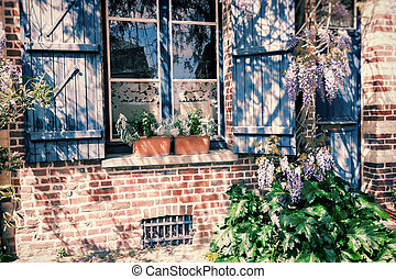 Old house window with blue shutters
