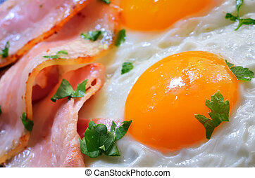 breakfast with bacon and fried eggs - fried egg with bacon...