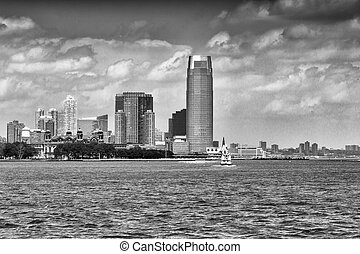 Jersey City skyline over Hudson river, New Jersey.