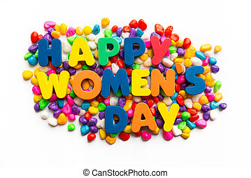 Happy Women's Day words on colorful stone