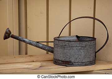 Watering pot - A rusty, galvanized vintage style watering...