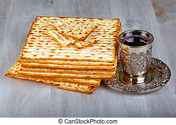 wine and matzoh - passover matzo with kiddush cup of wine on...