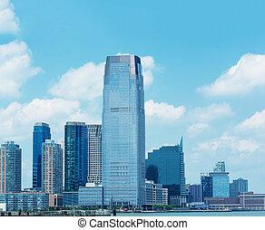 Jersey City skyline over Hudson river, New Jersey.