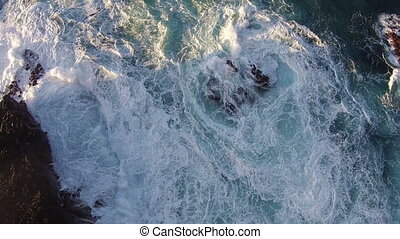 Flying over the Rocks and Ocean Waves