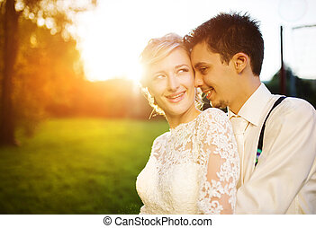 Young wedding couple on a summer meadow - Young wedding...