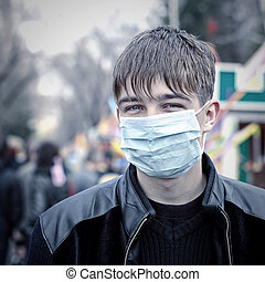 Teenager in the Flu Mask - Toned Photo of Teenager in the...