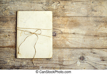 Old notebook on a wooden floor - Old notebook on a wooden...