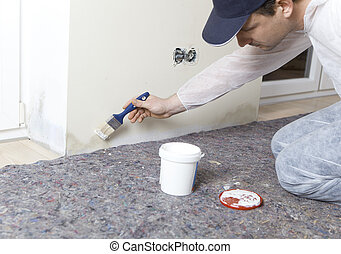Painters edited damp walls - Painter paints damp walls in an...