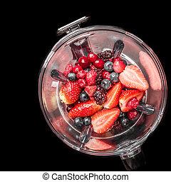Mixed Berries in Blender - Mixed berries in a blender viewed...