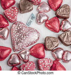 I Love You - many heart shaped chocolates in colorful...